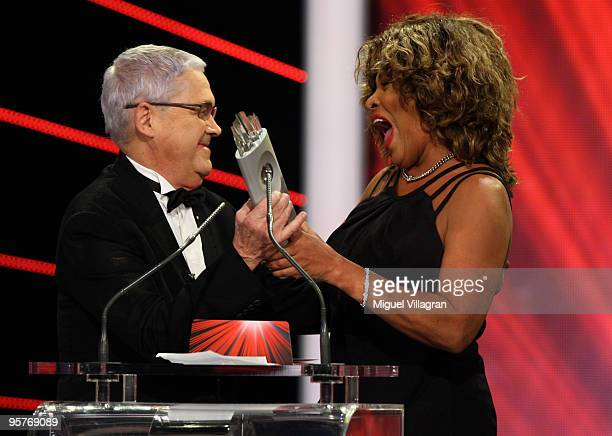 Claude Nobs the founder of the Montreux Jazz Festival hands over the Swiss award in the category show to US singer Tina Turner during the SwissAward...