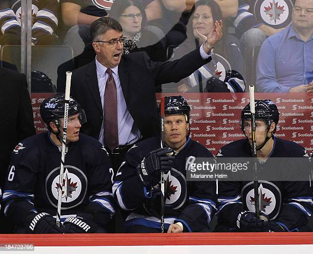 Claude Noel head coach of the Winnipeg Jets calls goaltender Ondrej Pavelev from the ice in third period action of an NHL game against the Montreal...