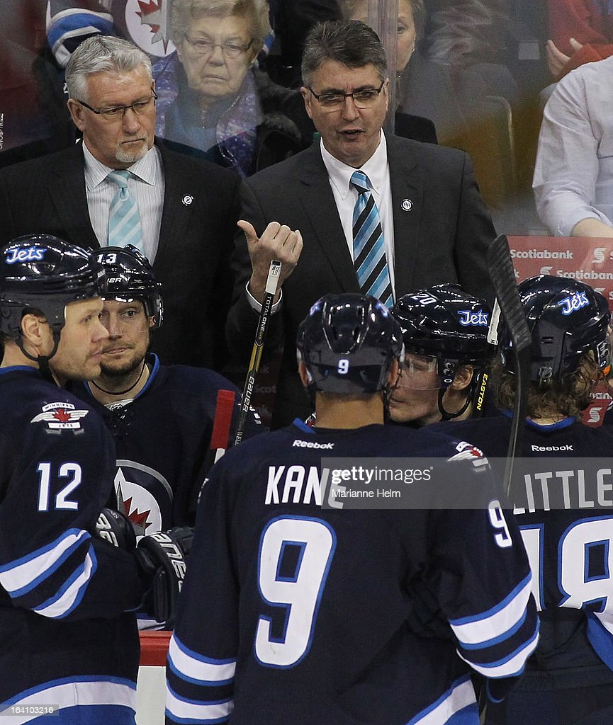 Claude Noel, head coach of the Winnipeg Jets gestures from the bench during a break in play in a game against the Boston Bruins during third period action on March 19, 2013 at the MTS Centre in Winnipeg, Manitoba, Canada.