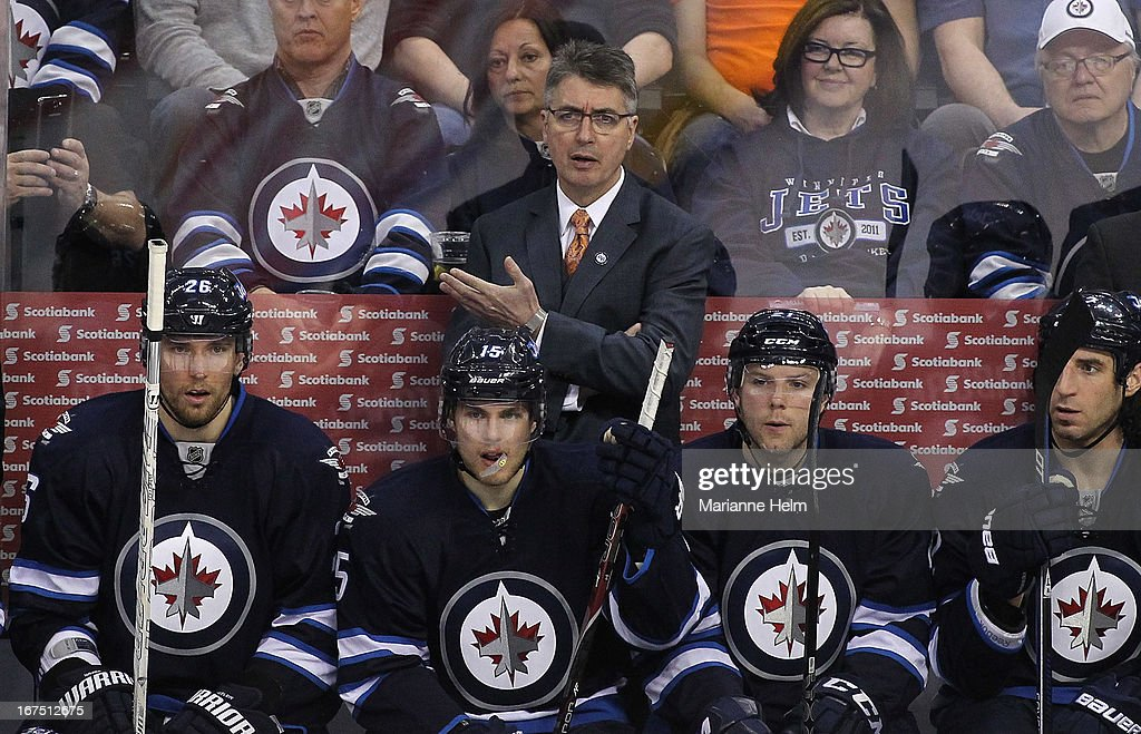 Claude Noel, head coach of the Winnipeg Jets, gestures from the bench during a game against the Montreal Canadiens during third period NHL action on April 25, 2013 at the MTS Centre in Winnipeg, Manitoba, Canada.