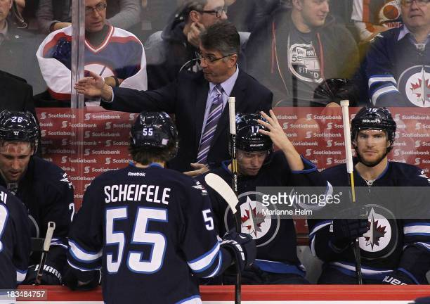 Claude Noel head coach of the Winnipeg Jets gestures from the bench in third period action of an NHL game against the Anaheim Ducks at the MTS Centre...