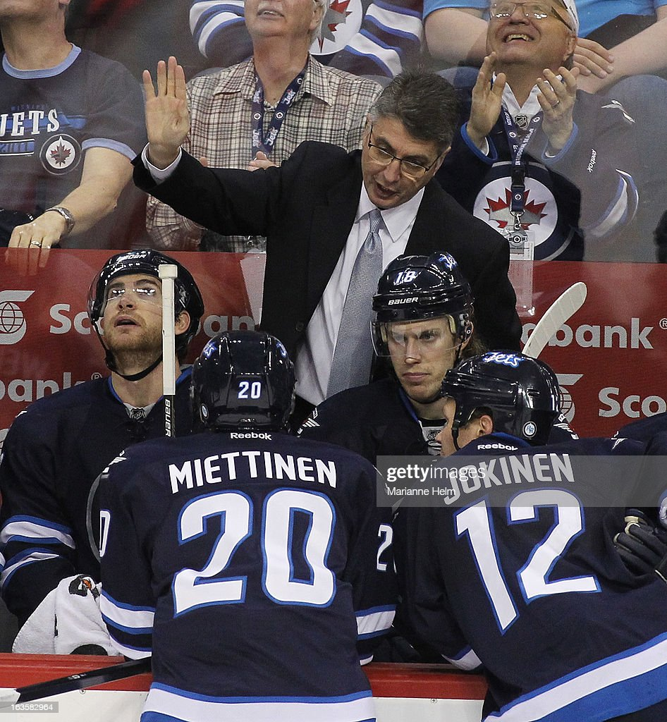 Claude Noel, head coach of the Winnipeg Jets gives direction from the bench during a break in play in a game against the Toronto Maple Leafs during third period action on March 12, 2013 at the MTS Centre in Winnipeg, Manitoba, Canada.
