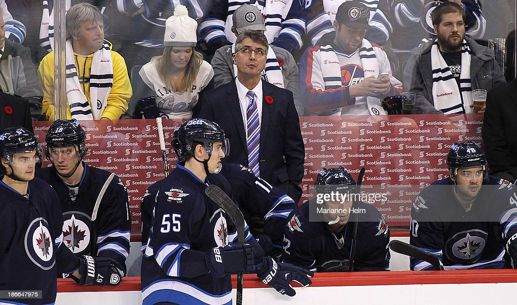 Claude Noel, head coach of the Winnipeg Jets, looks up to the replay in third period action in an NHL game against the Chicago Blackhawks at the MTS Centre on November 2, 2013 in Winnipeg, Manitoba, Canada.