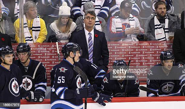 Claude Noel head coach of the Winnipeg Jets looks up to the replay in third period action in an NHL game against the Chicago Blackhawks at the MTS...