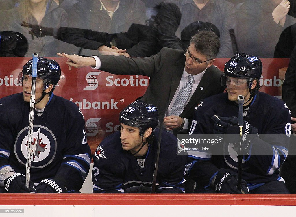 Claude Noel, head coach of the Winnipeg Jets, speaks with <a gi-track='captionPersonalityLinkClicked' href=/galleries/search?phrase=Nik+Antropov&family=editorial&specificpeople=202953 ng-click='$event.stopPropagation()'>Nik Antropov</a> #80 as <a gi-track='captionPersonalityLinkClicked' href=/galleries/search?phrase=Chris+Thorburn&family=editorial&specificpeople=2222066 ng-click='$event.stopPropagation()'>Chris Thorburn</a> #22 looks on from the bench during third period action in a game against the Florida Panthers on February 5, 2013 at the MTS Centre in Winnipeg, Manitoba, Canada.