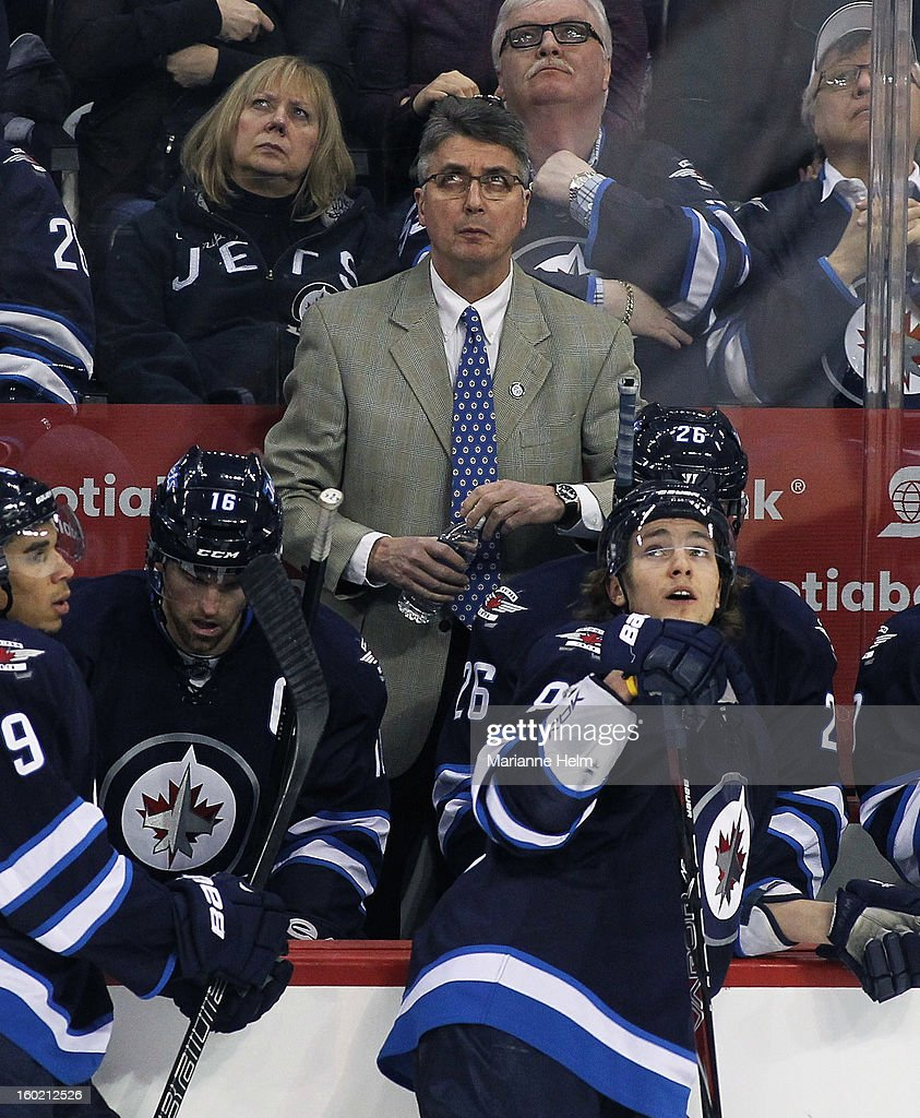 Claude Noel, head coach of the Winnipeg Jets, watches the replay on the scoreboard in a game against the New York Islanders in NHL action on January 27, 2013 at the MTS Centre in Winnipeg, Manitoba, Canada.