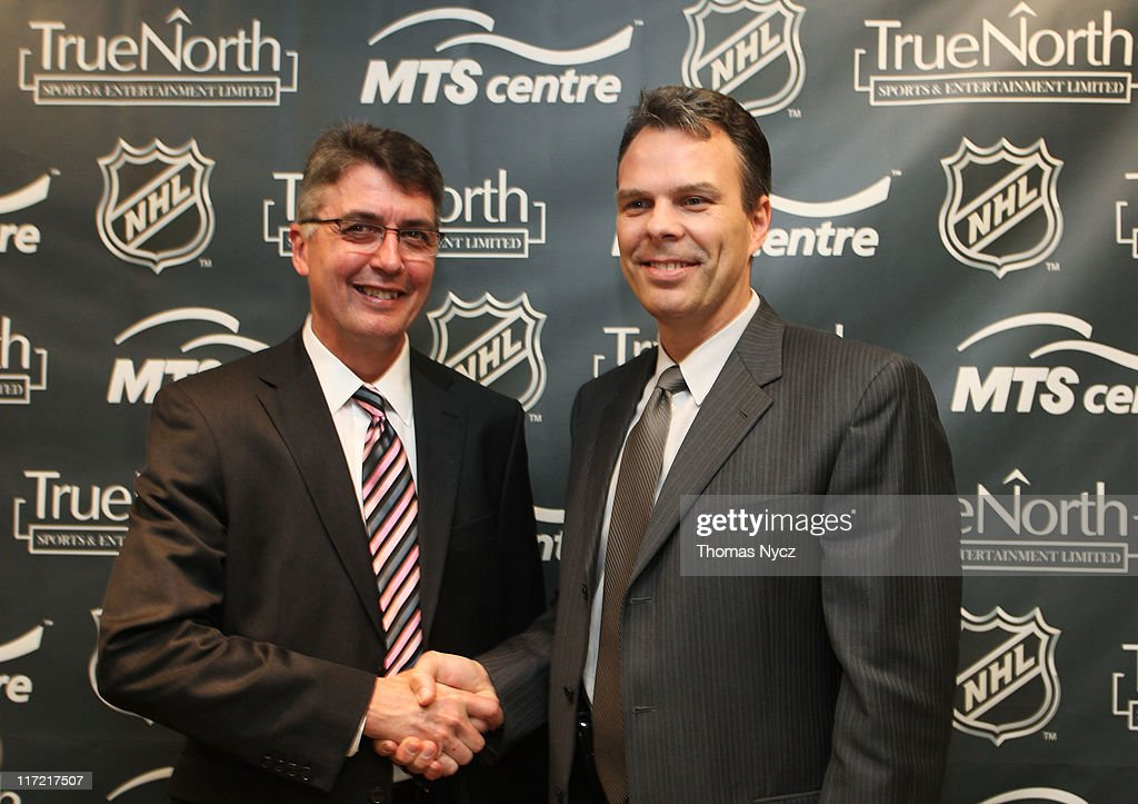 Claude Noel (L) shakes hands with by Kevin Cheveldayoff (R), Executive Vice Preident and General Manager of True North Sports and Entertainment, after being named head coach for Winnipeg's new NHL Team at the Westin Minneapolis on June 24, 2011 in Minneapolis, Minnesota.
