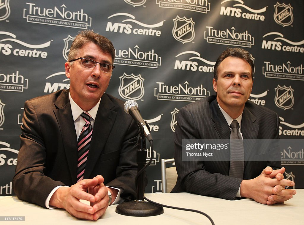 Claude Noel (L) speaks after being named head coach for Winnipeg's new NHL Team by Kevin Cheveldayoff (R), Executive Vice Preident and General Manager of True North Sports and Entertainment, at the Westin Minneapolis on June 24, 2011 in Minneapolis, Minnesota.