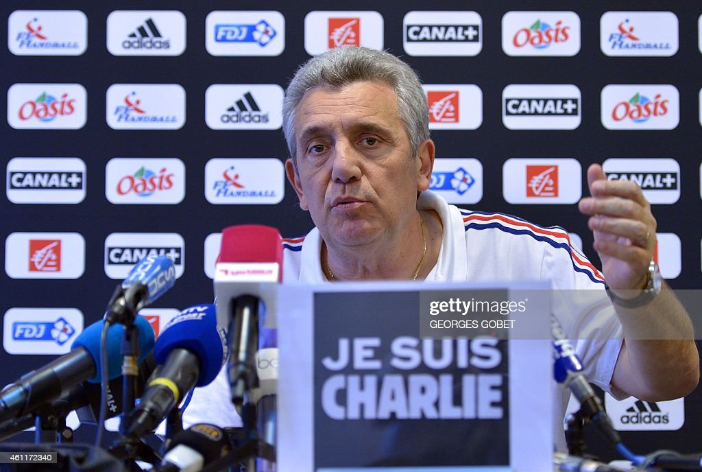 <a gi-track='captionPersonalityLinkClicked' href=/galleries/search?phrase=Claude+Onesta&family=editorial&specificpeople=792495 ng-click='$event.stopPropagation()'>Claude Onesta</a>, coach of the French national handball team, speaks during a press conference as he sits behind a sign reading ''I am Charlie'' during a press conference in Nantes on January 8, 2015. French security forces desperately hunted two brothers today suspected of gunning down 12 people in an Islamist attack on a satirical weekly, as a stunned and outraged France fell silent to mourn the victims.