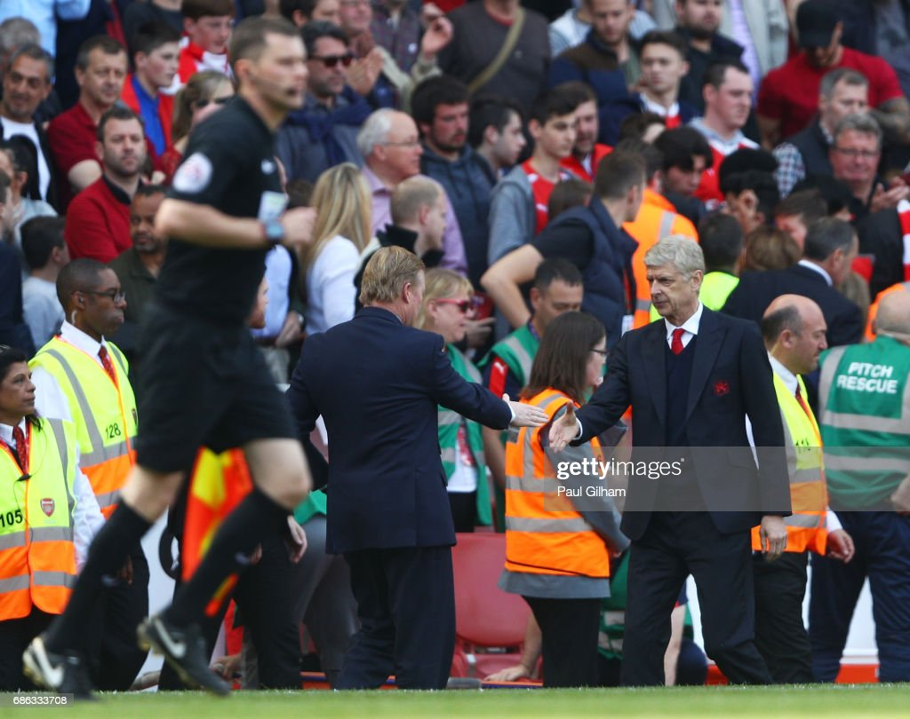 Claude Puel and Arsene Wenger shake hands during the Premier League match between Arsenal and Everton at Emirates Stadium on May 21, 2017 in London, England.