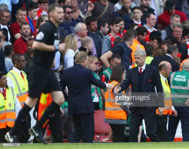 Claude Puel and Arsene Wenger shake hands during the Premier League match between Arsenal and Everton at Emirates Stadium on May 21 2017 in London...