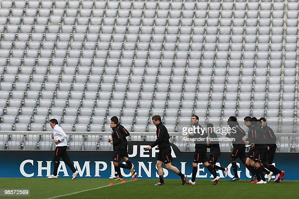 Claude Puel head coach of Olympic Lyon runs with his palyers during a training session at Allianz Arena on April 20 2010 in Munich Germany Olympic...