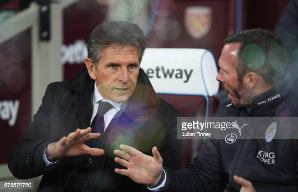 Claude Puel Manager of Leicester City and Michael Appleton assistant Manager of Leicester City in discussion prior to the Premier League match...