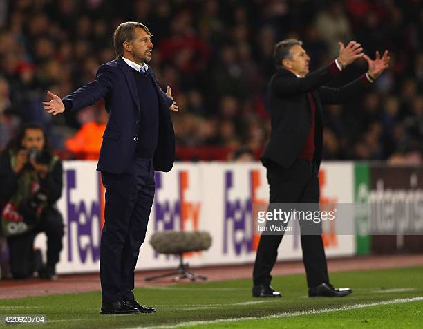 Claude Puel Manager of Southampton and Stefano Vecchi Manager of Internazionale react during the UEFA Europa League Group K match between Southampton...