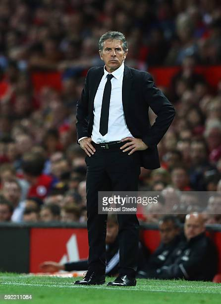 Claude Puel Manager of Southampton looks on during the Premier League match between Manchester United and Southampton at Old Trafford on August 19...