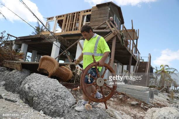 Claude Scee salvages what he can from his fatherinlaws home that was destroyed by hurricane Irma on September 17 2017 in Summerland Key Florida The...