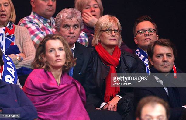 Claude Serillon his wife Catherine Ceylac Francois Baroin attend day one of the Davis Cup tennis final between France and Switzerland at the Grand...