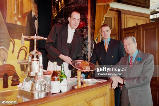 Claude Terrail owner of the famous La Tour d'Argent restaurant in Paris and his son Andre attend the serving of the restaurant's millionth duck The...