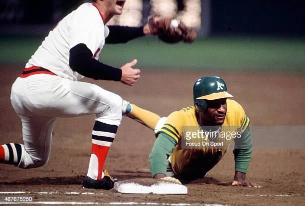 Claudell Washington of the Oakland Athletics dives back into first base safe beating the tag of Carl Yastrzemski of the Boston Red Sox during an...