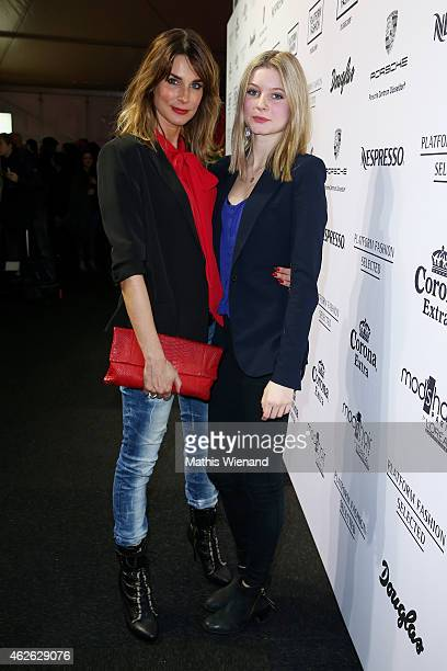 Claudelle Deckert and daughter attend the Platform Fashion Selected show during the Platform Fashion February 2015 on February 1 2015 in Duesseldorf...