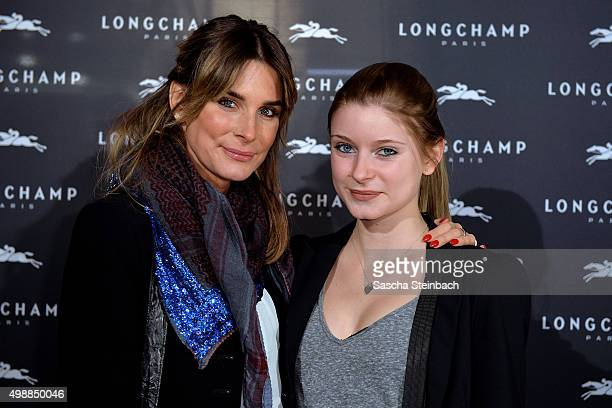 Claudelle Deckert and her daughter Romy attend the Longchamp store opening on November 26 2015 in Cologne Germany