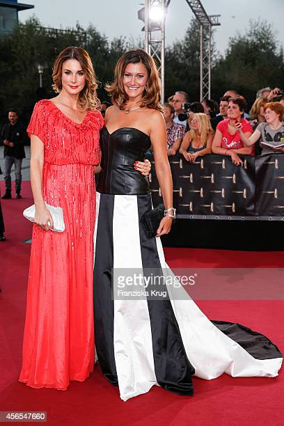 Claudelle Deckert and Sandra Thier attend the red carpet of the Deutscher Fernsehpreis 2014 on October 02 2014 in Cologne Germany