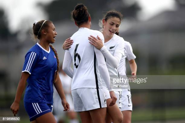 Claudia Bunge of New Zealand congratulates Grace Jale on her goal during the Oceania U19 Womens Championship match between New Zealand and Samoa at...