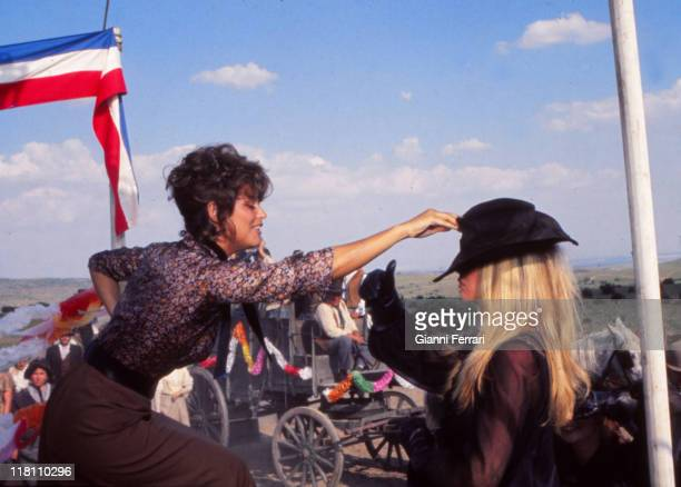 Claudia Cardinale and Brigitte Bardot during the filmation of the movie 'Las Petroleras' near Madrid directed by Christian Jacque Madrid Spain
