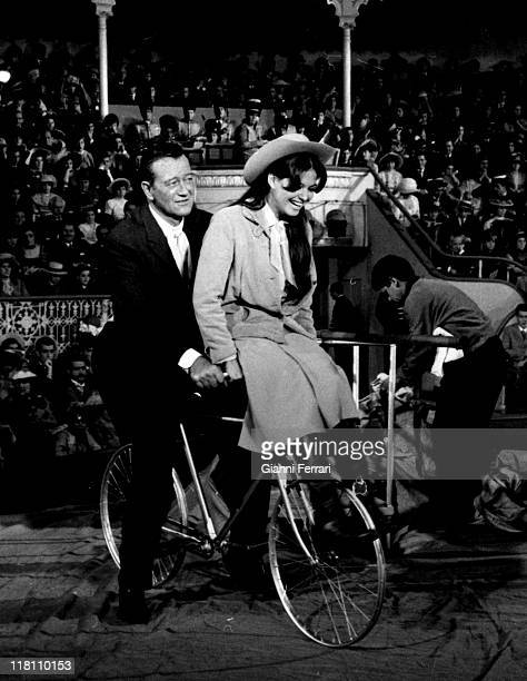 Claudia Cardinale and John Wayne during the filmation of the movie 'Circus World' directed by Henry Hathaway Madrid Spain