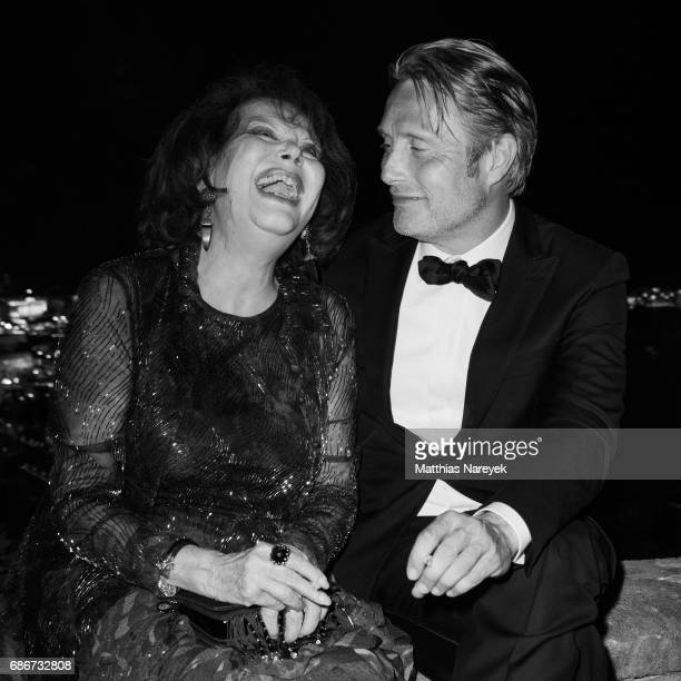 Claudia Cardinale and Mads Mikkelsen attend the Women in Motion Awards Dinner at the 70th Cannes Film Festival at Place de la Castre on May 21 2017...