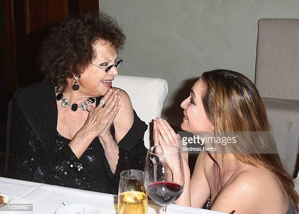 Claudia Cardinale chats with Alexandra Kamp during the reception to the 150th anniversary of Italy unification at the Italian embassy to Germany on...