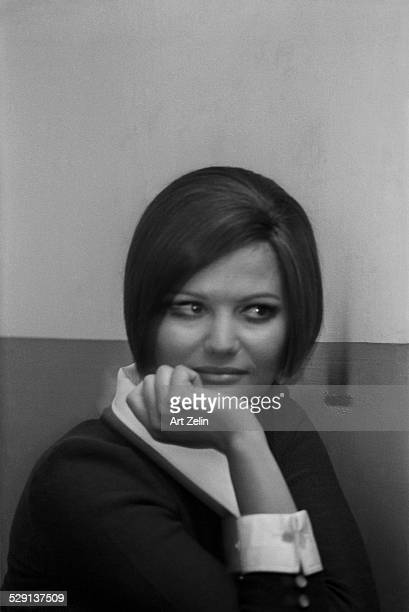 Claudia Cardinale smiling in white collar and cuffs circa 1970 New York