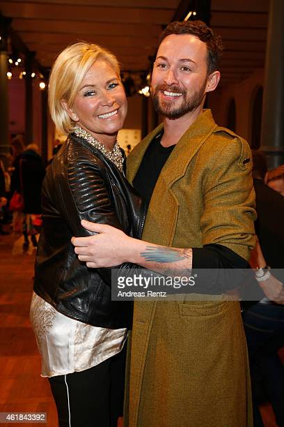 Claudia Effenberg and Marcel Ostertag pose at the Marcel Ostertag show at Magazin at Heeresbaeckerei on January 20 2015 in Berlin Germany