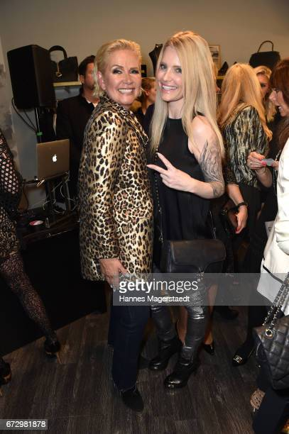 Claudia Effenberg and Mirja du Mont during the 'Kunst Kleid' fashion cocktail on April 25 2017 in Munich Germany