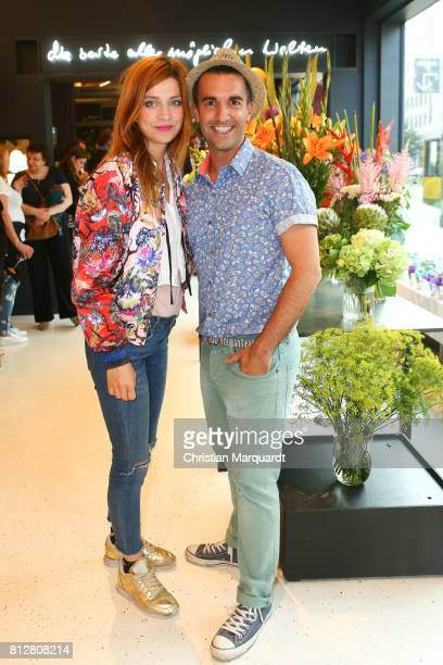Claudia Eisinger and Kian ShamsDolatabadi attend the 'Kians Garden Flower Shop' Opening Event at Kantstrasse on July 11 2017 in Berlin Germany