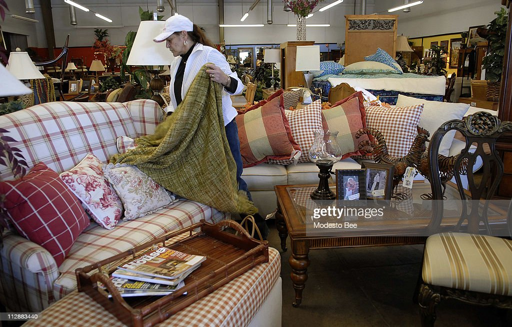 Claudia Fontenot, of Modesto, California, takes a closer look at this loveseat at K.P.'s Consignment store in Modesto, Thursday, February 14, 2008.