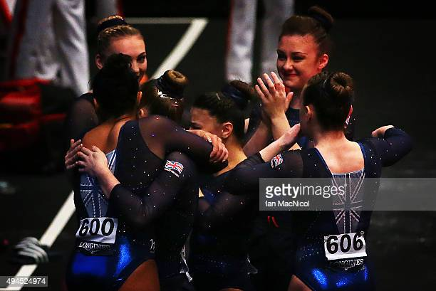 Claudia Frangapane Amy Tinkler Elissa Downie Ruby Harrold Kelly Sim and Rebecca Downie of Great Britain celebrate during day five of World Artistic...