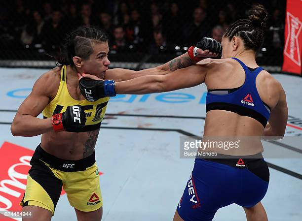 Claudia Gadelha of Brazil and Cortney Casey of the United States trade punches during their women's strawweight bout at the UFC Fight Night Bader v...
