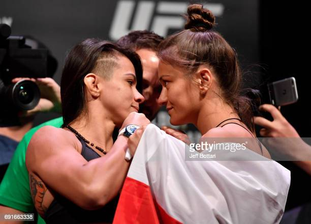 Claudia Gadelha of Brazil and Karolina Kowalkiewicz of Poland face off during the UFC 212 weighin at Jeunesse Arena on June 2 2017 in Rio de Janeiro...