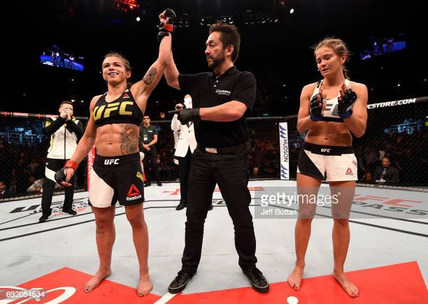 Claudia Gadelha of Brazil celebrates her submission victory over Karolina Kowalkiewicz of Poland in their womens strawweight bout during the UFC 212...