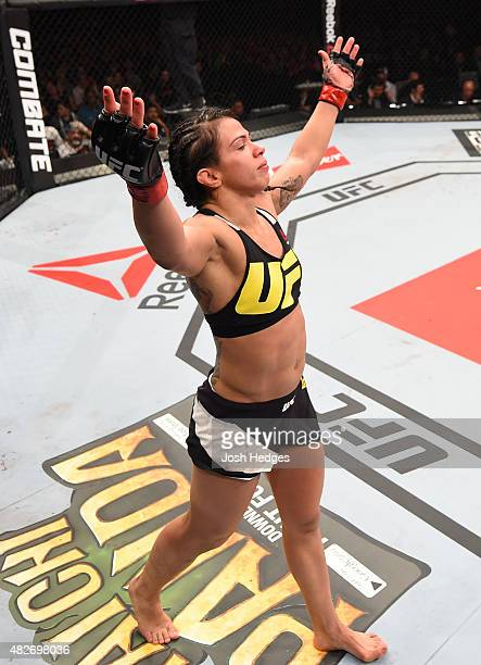 Claudia Gadelha of Brazil celebrates her victory over Jessica Aguilar of the United States in their women's strawweight bout during the UFC 190 event...
