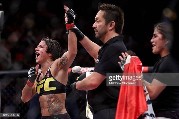Claudia Gadelha of Brazil celebrates her win overJessica Aguilar of the United States in their strawweight bout during the UFC 190 Rousey v Correia...