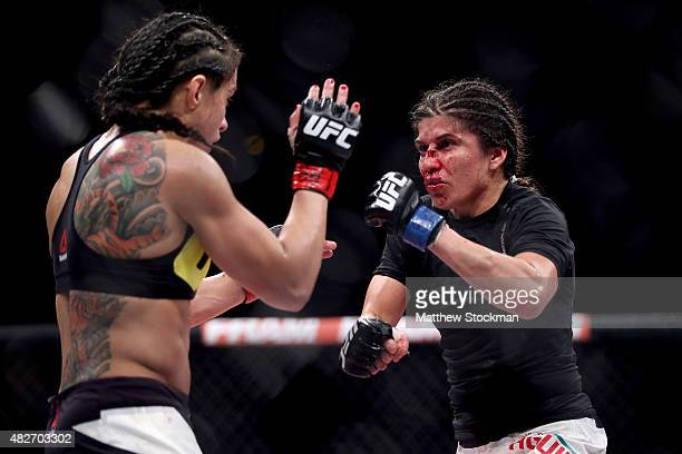 Claudia Gadelha of Brazil fights Jessica Aguilar of the United States in their strawweight bout during the UFC 190 Rousey v Correia at HSBC Arena on...