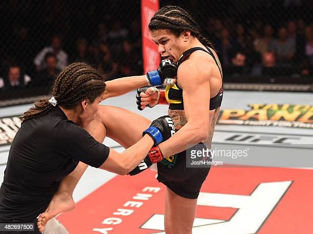 Claudia Gadelha of Brazil kicks Jessica Aguilar of the United States in their women's strawweight bout during the UFC 190 event inside HSBC Arena on...