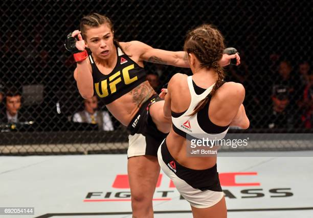 Claudia Gadelha of Brazil kicks Karolina Kowalkiewicz of Poland in their womens strawweight bout during the UFC 212 event at Jeunesse Arena on June 3...