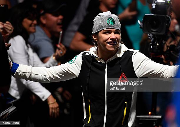 Claudia Gadelha of Brazil prepares to enter the Octagon before her women's strawweight championship bout against Joanna Jedrzejczyk during The...