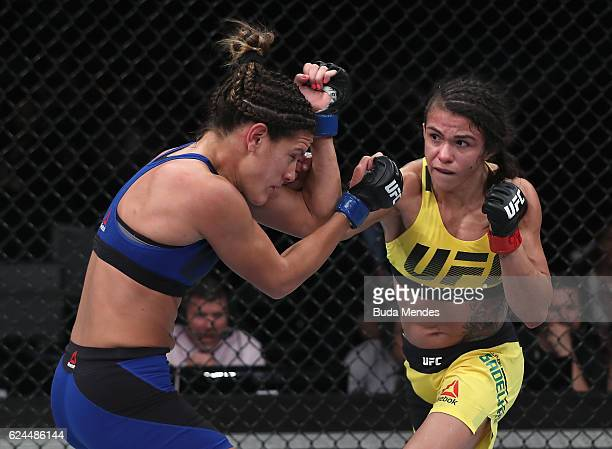Claudia Gadelha of Brazil punches Cortney Casey of the United States during their women's strawweight bout at the UFC Fight Night Bader v Minotouro...