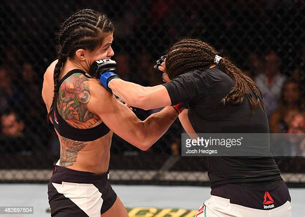 Claudia Gadelha of Brazil punches Jessica Aguilar of the United States in their women's strawweight bout during the UFC 190 event inside HSBC Arena...