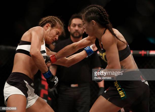 Claudia Gadelha of Brazil punches Karolina Kowalkiewicz of Poland in their womens strawweight bout during the UFC 212 event at Jeunesse Arena on June...