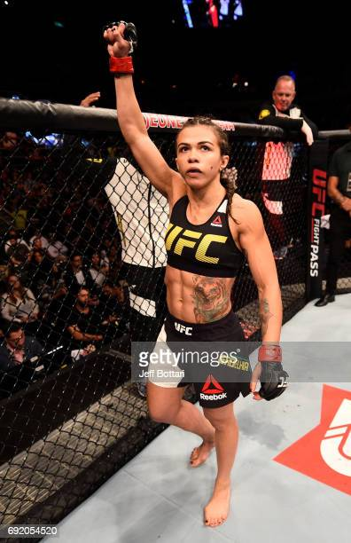 Claudia Gadelha of Brazil stands in the Octagon prior to her womens strawweight bout against Karolina Kowalkiewicz of Poland during the UFC 212 event...